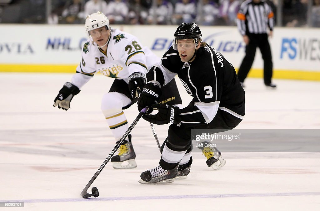 Jack Johnson #3 of the Los Angeles Kings is pursued by <a gi-track='captionPersonalityLinkClicked' href=/galleries/search?phrase=Jere+Lehtinen&family=editorial&specificpeople=239506 ng-click='$event.stopPropagation()'>Jere Lehtinen</a> #26 of the Dallas Stars in the first period at Staples Center on March 27, 2010 in Los Angeles, California.