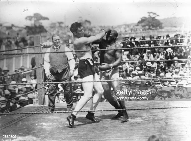 Jack Johnson right of the USA world heavyweight title holder since 1908 in action against Jess Willard of the USA at Havana Cuba in 1915 Willard took...