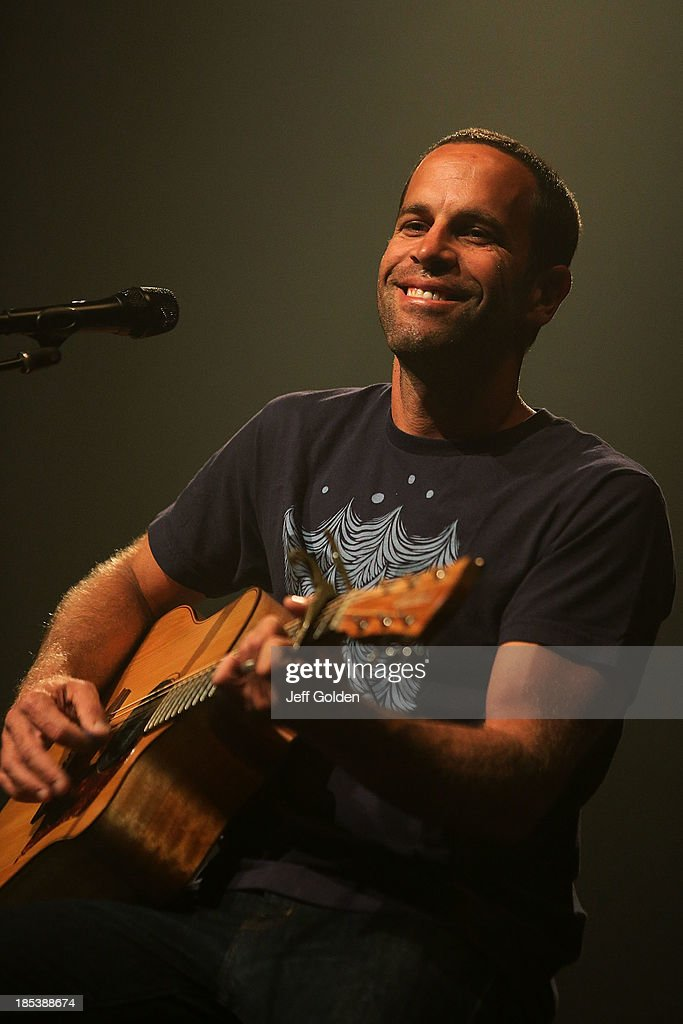 Jack Johnson smiles as he performs at Orpheum Theatre on October 19, 2013 in Los Angeles, California.