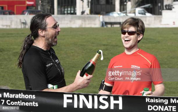 Jack Jones and his American team mate Chris Cuddihy celebrate in Hyde Park after completing the 777 Ultra Marathon Challenge The British runner set a...