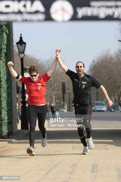 Jack Jones and his American team mate Chris Cuddihy cross the finish line at the Wellington Arch in Hyde Park Corner to complete the 777 Ultra...