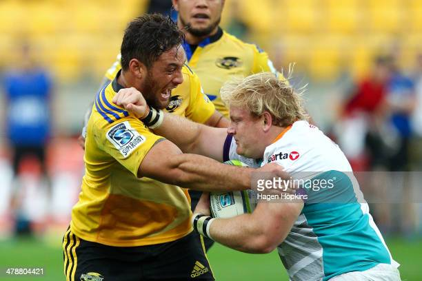 Jack Lam of the Hurricanes tackles Adriaan Strauss of the Cheetahs during the round five Super Rugby match between the Hurricanes and the Cheetahs at...