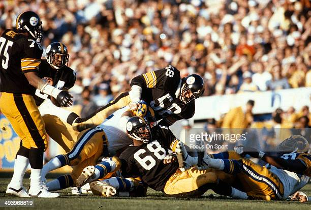 Jack Lambert and LC Greenwood of the Pittsburgh Steelers tackles Cullen Bryant of the Los Angeles Rams during Super Bowl XIV on January 20 1980 at...