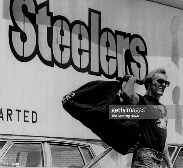 Jack Lambert of the Pittsburgh Steelers carries a duffle bag circa 1970s
