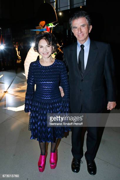 Jack Lang and his wife Monique pose in front the works of JeanPaul Goude during the 'Societe des Amis du Musee d'Art Moderne du Centre Pompidou'...