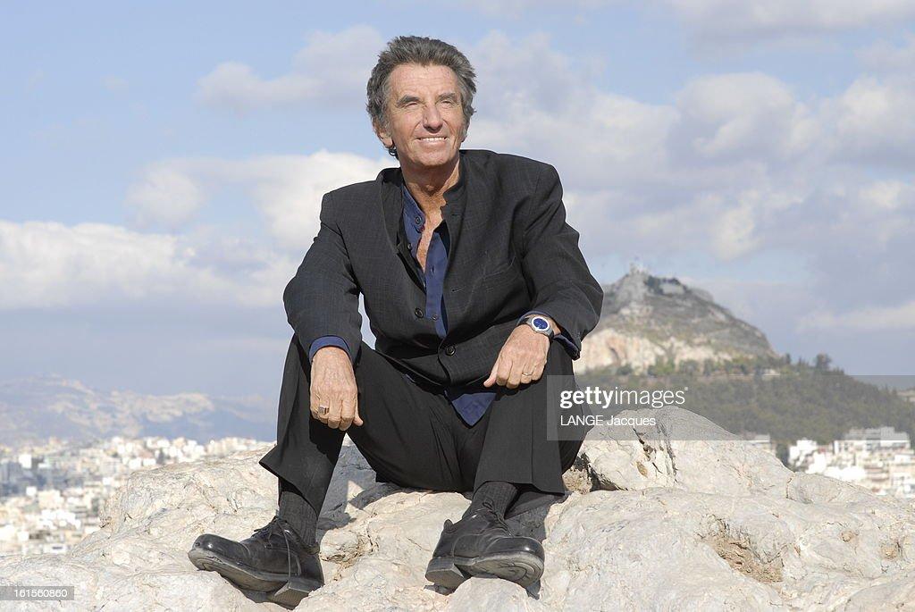 <a gi-track='captionPersonalityLinkClicked' href=/galleries/search?phrase=Jack+Lang&family=editorial&specificpeople=220296 ng-click='$event.stopPropagation()'>Jack Lang</a> Travel In Greece. Jack LANG tourne en Grèce un documentaire pour Arte où il présente le dramaturge grec Sophocle : Jack LANG tout de noir vêtu, posant assis sur la Pnyx, haut lieu de naissance de la démocratie.