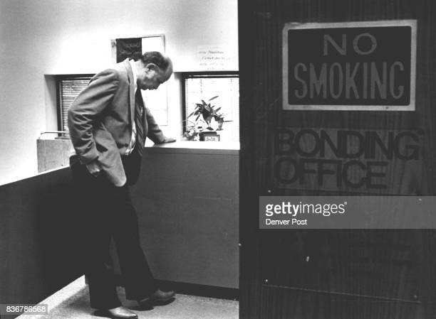 Jack Largent waits at bonding office at the Denver PD to try to bail out Dan McLaughlen Credit The Denver Post