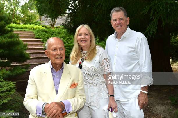 Jack Larsen Michele Cohen and Martin Cohen attend Boom The Cosmic LongHouse Benefit at LongHouse Reserve on July 22 2017 in East Hampton New York