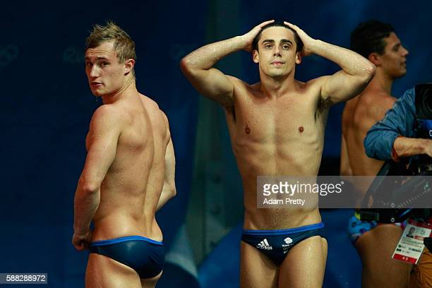 Jack Laugher and Chris Mears of Great Britain react after their final jump in the Men's Diving Synchronised 3m Springboard Final on Day 5 of the Rio...