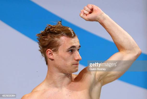 Jack Laugher of England celebrates after winning the gold medal in the Men's 1m Springboard Final at Royal Commonwealth Pool during day seven of the...