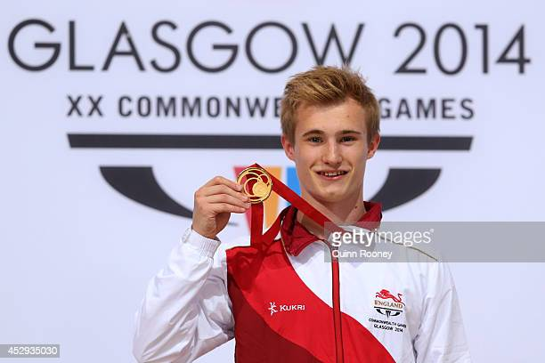 Jack Laugher of England poses with the gold medal during the medal ceremony for the Men's 1m Springboard Final at Royal Commonwealth Pool during day...