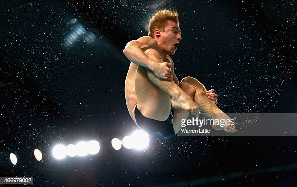 Jack Laughof Great Britain dives during the Men's 3m Springboard semi final on day two of the 2015 FINA/NVA Diving World Series at the Hamdan Sports...