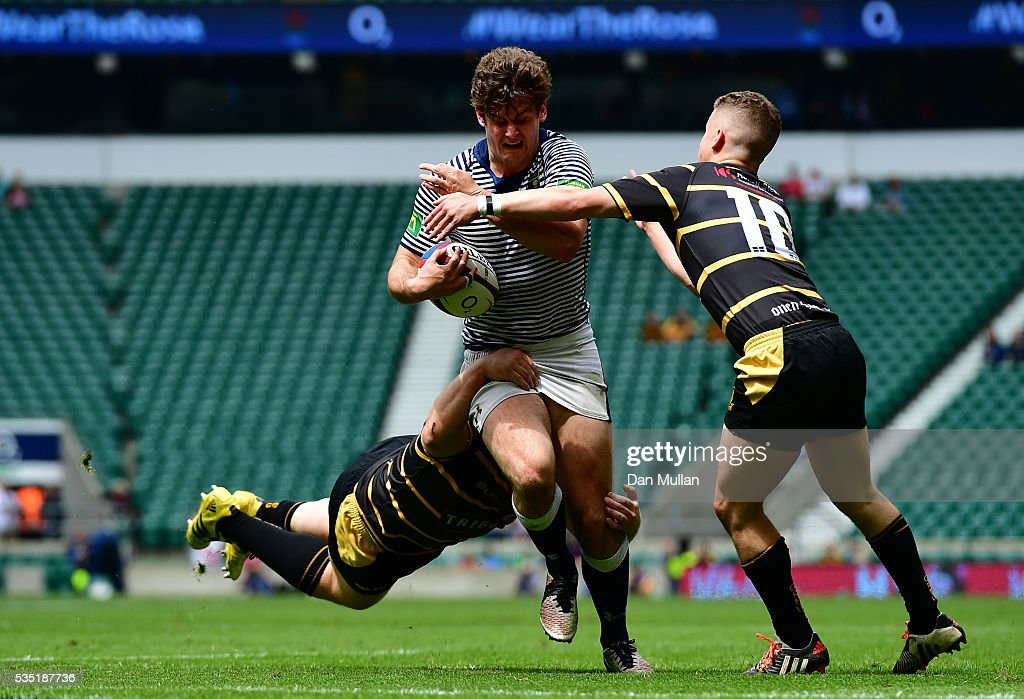 Jack Lavin of Cheshire is tackled by Tom Cowan-Dickie and Billy Searle of Cornwall during the 2016 Bill Beaumont Cup Final between Cornwall and Cheshire at Twickenham Stadium on May 29, 2016 in London, England.