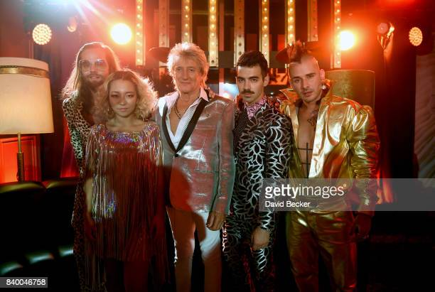 Jack Lawless and JinJoo Lee of DNCE Sir Rod Stewart and Joe Jonas and Cole Whittle of DNCE attend a pretaping for the 2017 MTV Video Music Awards at...