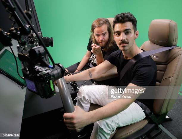 Jack Lawless and Joe Jonas of DNCE attend the VMA after party hosted by Republic Records and Cadillac at TAO restaurant at the Dream Hotel on August...