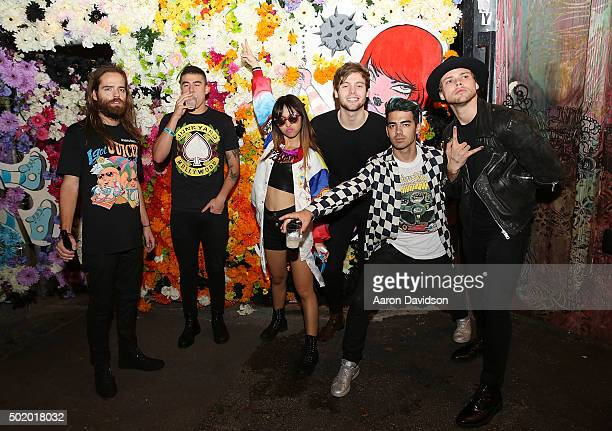 Jack Lawless Calum Hood JinJoo Lee Ashton Irwin Joe Jonas and Luke Hemmings attend DNCE Jingle Ball after party on December 18 2015 in Miami Florida