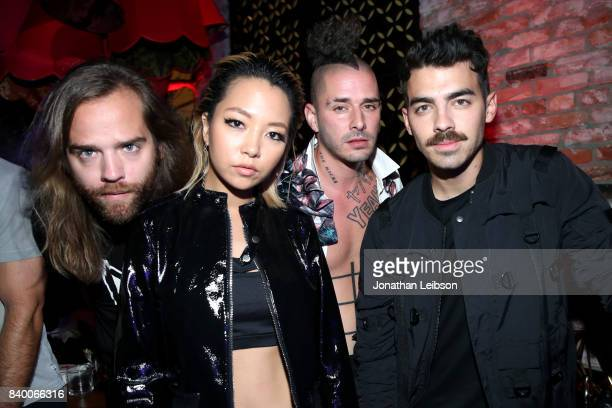 Jack Lawless JinJoo Lee Cole Whittle and Joe Jonas of DNCE at Republic Records VMA Party presented in partnership with FIJI Water at TAO at the Dream...