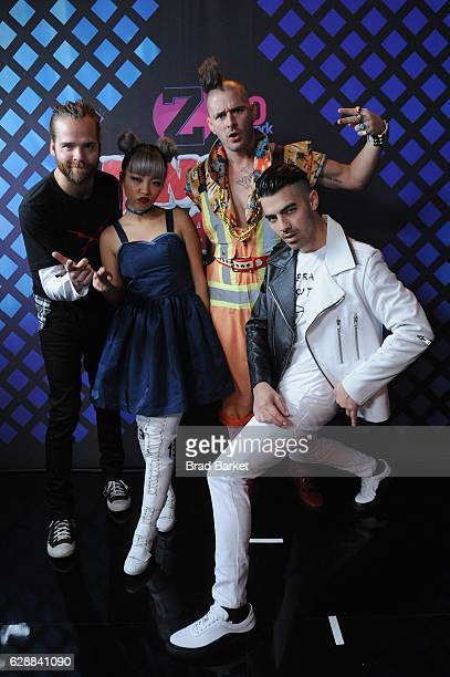 Jack Lawless JinJoo Lee Cole Whittle and Joe Jonas of DNCE attend the broadcast room at the Z100's Jingle Ball 2016 at Madison Square Garden on...