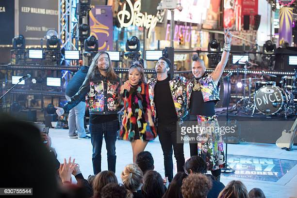 Jack Lawless JinJoo Lee Joe Jonas and Cole Whittle of DNCE perform during New Year's Eve 2017 in Times Square on December 31 2016 in New York City