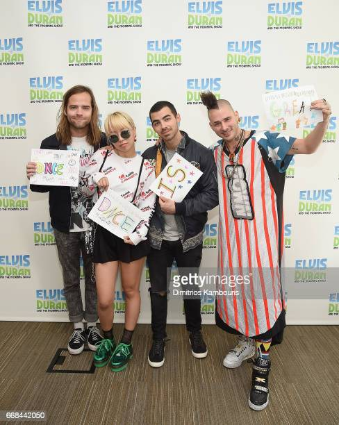 Jack Lawless JinJoo Lee Joe Jonas and Cole Whittle of music group DNCE visit 'The Elvis Duran Z100 Morning Show' at Z100 Studio on April 14 2017 in...