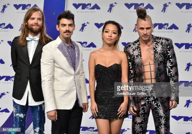 Jack Lawless Joe Jonas JinJoo Lee and Cole Whittle of DNCE arrive at the 2017 MTV Video Music Awards at The Forum on August 27 2017 in Inglewood...