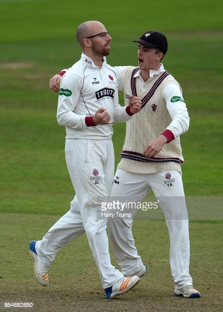 Jack Leach and Tom Abell of Somerset celebrate after dismissing Nick Compton of Middlesex during Day Three of the Specsavers County Championship...