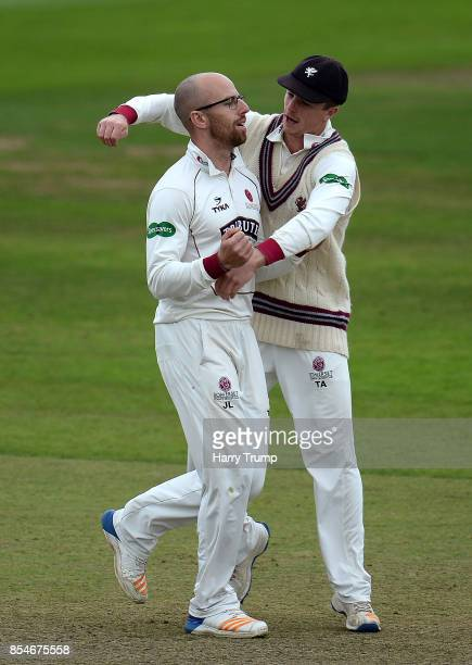 Jack Leach and Tom Abell of Somerset celebrates after dismissing Nick Compton of Middlesex during Day Three of the Specsavers County Championship...