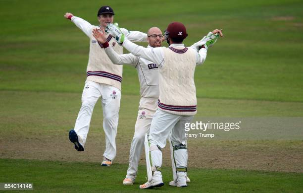 Jack Leach of Somerset celebrates after dismissing Dawid Malan of Middlesex with Steve Davies and Tom Abell of Somerset during Day Two of the...