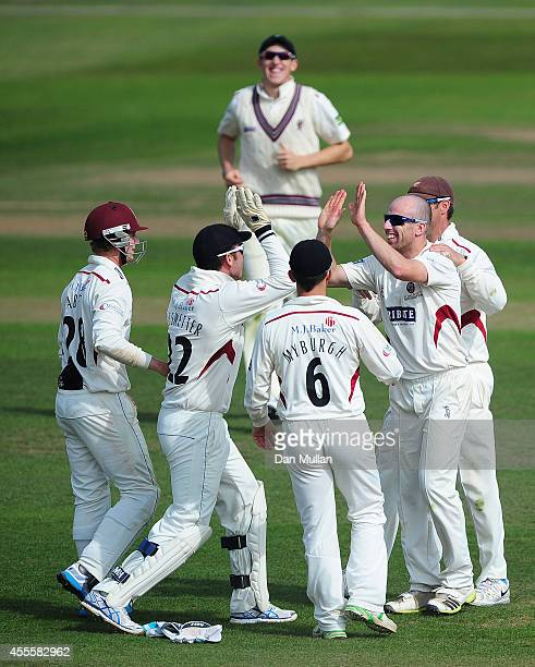 Jack Leach of Somerset celebrates with his team mates after taking the wicket of Eoin Morgan of Middlesex during day three of the LV County...