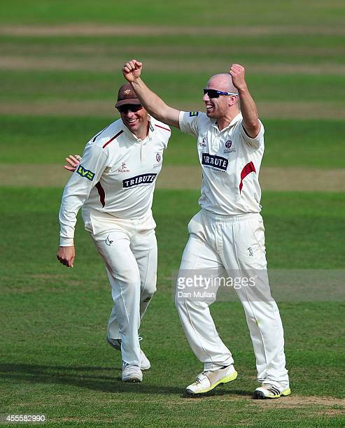 Jack Leach of Somerset celebrates with team mate Marcus Trescothick after taking the wicket of Eoin Morgan of Middlesex during day three of the LV...
