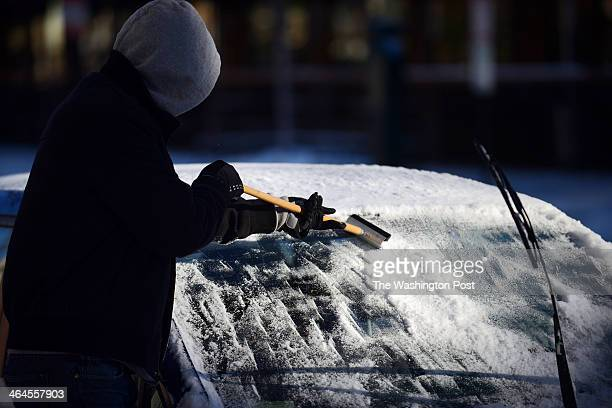 Jack Leathers who is a teacher but received a day off due to the winter storm tries to remove the ice from his front window of his car