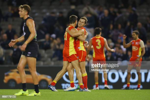 Jack Leslie of the Suns celebrates the win with Kade Kolodjashnij during the round four AFL match between the Carlton Blues and the Gold Coast Suns...