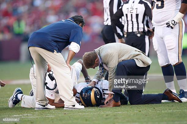 Jack Long of the St Louis Rams gets checked out after getting a concussion during the game against the San Francisco 49ers at Candlestick Park on...