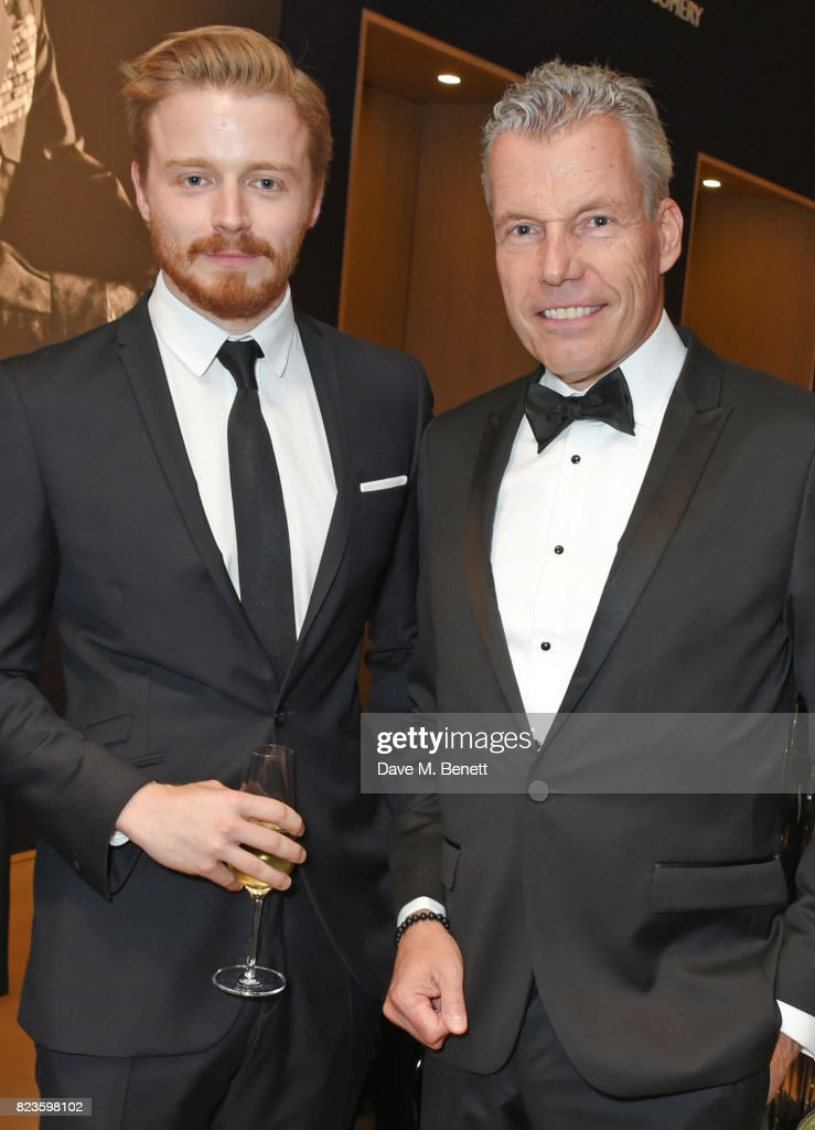 Jack Lowden (L) and Torsten Muller-Otvos, Chief Executive, Rolls-Royce Motor Cars, attend the world premiere of the 'The Great Eight Phantoms - A Rolls-Royce Exhibition' at Bonhams on July 27, 2017 in London, England.