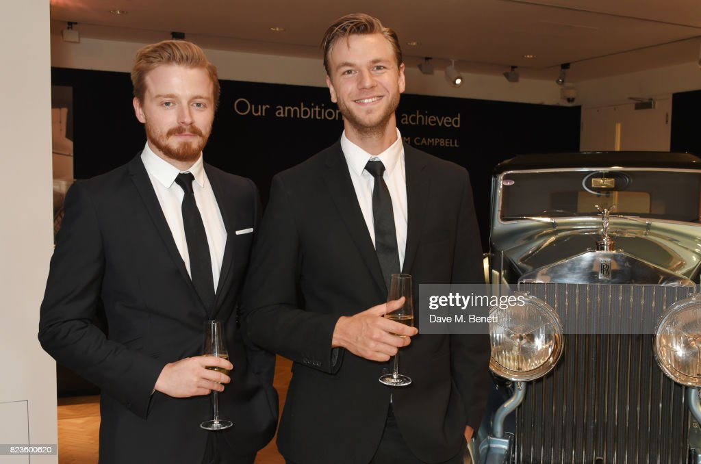 Jack Lowden (L) and Wilf Scolding attend the world premiere of the 'The Great Eight Phantoms - A Rolls-Royce Exhibition' at Bonhams on July 27, 2017 in London, England.
