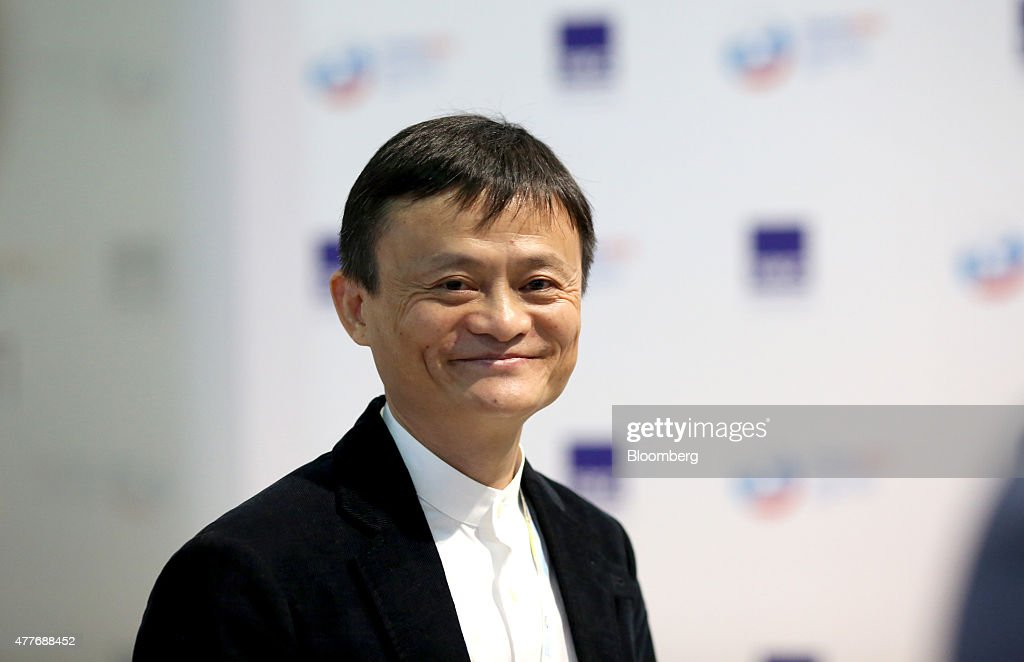 <a gi-track='captionPersonalityLinkClicked' href=/galleries/search?phrase=Jack+Ma&family=editorial&specificpeople=2110288 ng-click='$event.stopPropagation()'>Jack Ma</a>, billionaire and chairman of Alibaba Group Holding Ltd., reacts as he arrives for sessions at the St. Petersburg International Economic Forum (SPIEF) in Saint Petersburg, Russia, on Friday, June 19, 2015. SPIEF is an annual international conference dedicated to economic and business issues which takes place at the Lenexpo exhibition center June 18-20. Photographer: Chris Ratcliffe/Bloomberg via Getty Images