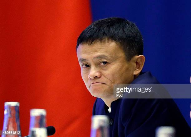 Jack Ma CEO of Alibaba listens as Chinese President Xi Jinping speaks at a USChina business roundtable comprised of US and Chinese CEOs on September...