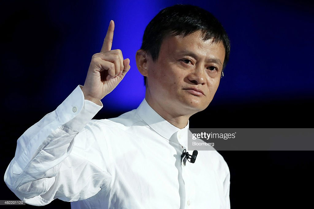 <a gi-track='captionPersonalityLinkClicked' href=/galleries/search?phrase=Jack+Ma&family=editorial&specificpeople=2110288 ng-click='$event.stopPropagation()'>Jack Ma</a>, chairman of Alibaba Group Holding Ltd., gestures as he speaks at SoftBank World 2014 in Tokyo, Japan, on Tuesday, July 15, 2014. As SoftBank Corp. Chief Executive Officer Masayoshi Son pushes for a takeover of T-Mobile US Inc., the Japanese billionaire is asking banks to commit financing for a longer-than-usual amount of time, underscoring the intense regulatory review he faces. Photographer: Kiyoshi Ota/Bloomberg via Getty Images