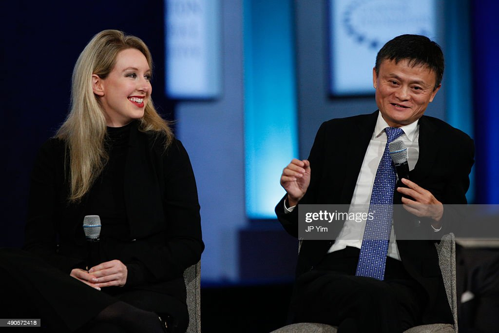 <a gi-track='captionPersonalityLinkClicked' href=/galleries/search?phrase=Jack+Ma&family=editorial&specificpeople=2110288 ng-click='$event.stopPropagation()'>Jack Ma</a>, Executive Chairman of Alibaba Group speaks on stage as <a gi-track='captionPersonalityLinkClicked' href=/galleries/search?phrase=Elizabeth+Holmes+-+Businesswoman&family=editorial&specificpeople=14311810 ng-click='$event.stopPropagation()'>Elizabeth Holmes</a> (L) listens during the closing session of the Clinton Global Initiative 2015 on September 29, 2015 in New York City.