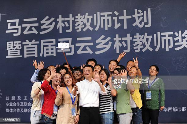 Jack Ma founder and chairman of Alibaba Group takes selfies with rural teachers during a ceremony of Jack Ma Rural Teachers Plan at Beijing Normal...