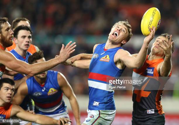 Jack Macrae of the Bulldogs competes for the ball against Josh Kelly of the Giants during the round six AFL match between the Greater Western Sydney...
