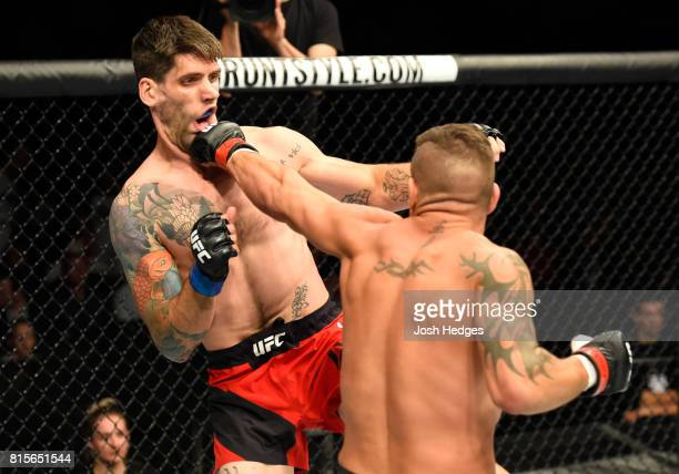 Jack Marshman of Wales punches Ryan Janes of Canada in their middleweight bout during the UFC Fight Night event at the SSE Hydro Arena Glasgow on...