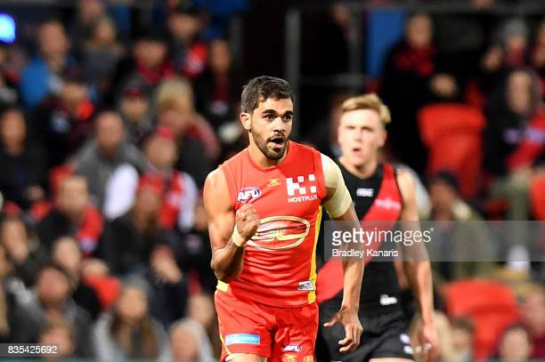 Jack Martin of the Suns celebrates kicking a goal during the round 22 AFL match between the Gold Coast Suns and the Essendon Bombers at Metricon...