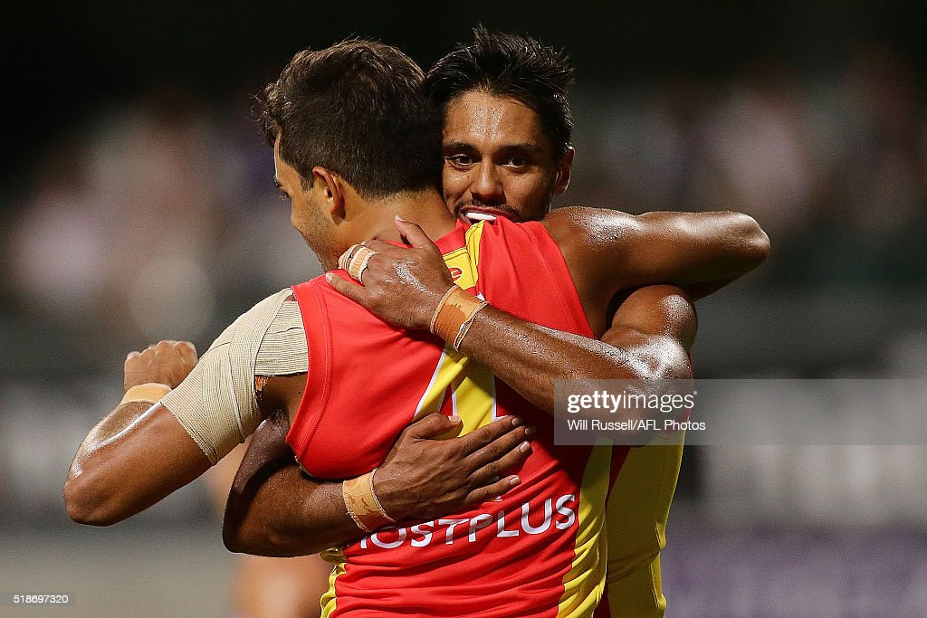 Jack Martin of the Suns celebrates with teammate Aaron Hall after scoring a goal during the round two AFL match between the Fremantle Dockers and the...