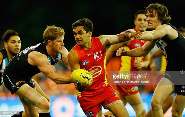 Jack Martin of the suns in action during the round 23 AFL match between the Gold Coast Suns and the Port Adelaide Power at Metricon Stadium on August...