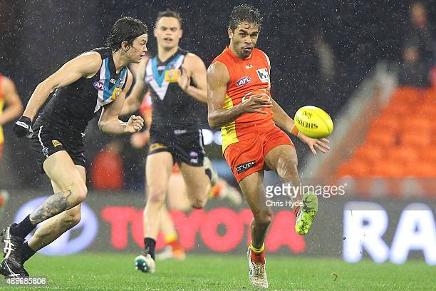 Jack Martin of the Suns kicks during the round 22 AFL match between the Gold Coast Suns and the Port Adelaide Power at Metricon Stadium on August 29...