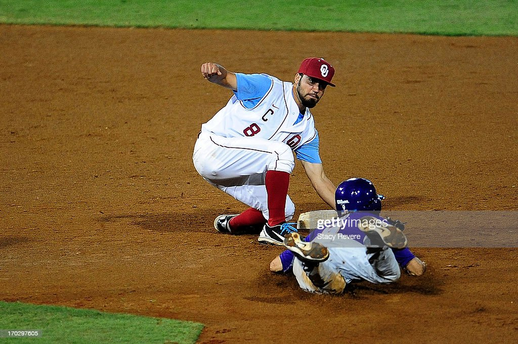 Jack Mayfield #8 of the Oklahoma Sooners tags Mark Laird #9 of the LSU Tigers during Game 2 of the NCAA baseball Super Regionals at Alex Box Stadium on June 8, 2013 in Baton Rouge, Louisiana.