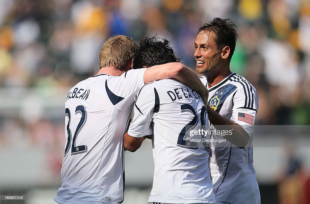 Jack McBean #32, A.J. DeLaGarza #20 and Marcelo Sarvas #8 of the Los Angeles Galaxy celebrate McBean's goal against Chivas USA in the second half during their MLS match at The Home Depot Center on March 17, 2013 in Carson, California. Chivas USA and the Los Angeles Galaxy played to a 1-1 draw.