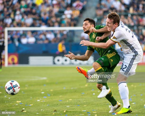 Jack McBean of Los Angeles Galaxy takes an elbow from Sebastian Blanco of Portland Timbers during Los Angeles Galaxy's MLS match against Portland...