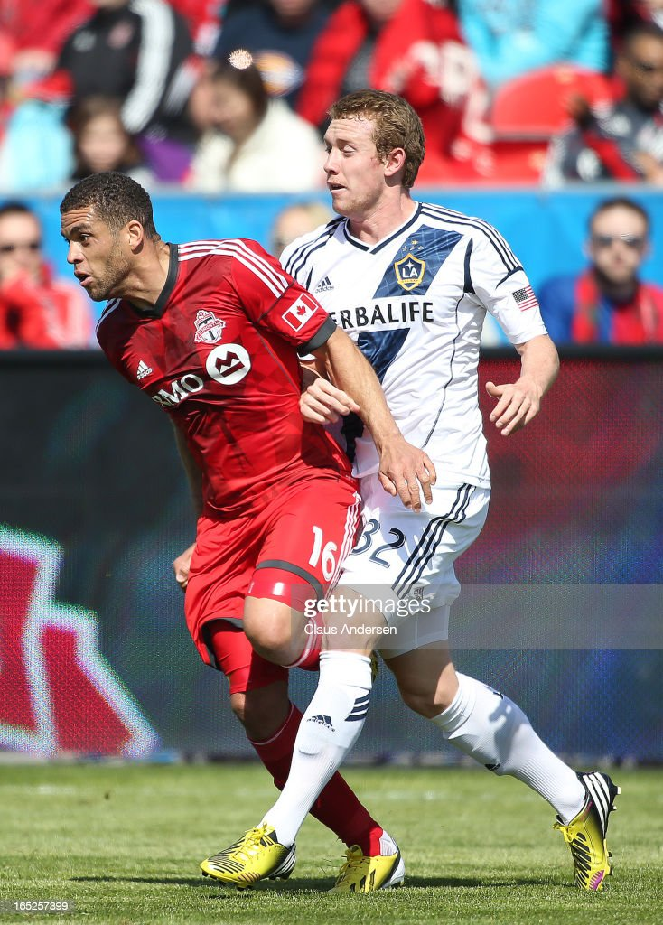 Jack McBean #32 of the Los Angeles Galaxy defends against Darel Russell #16 of the Toronto FC in an MLS game on March 30, 2013 at BMO field in Toronto, Ontario, Canada. The LA Galaxy and the Toronto FC played to a 2-2 tie.